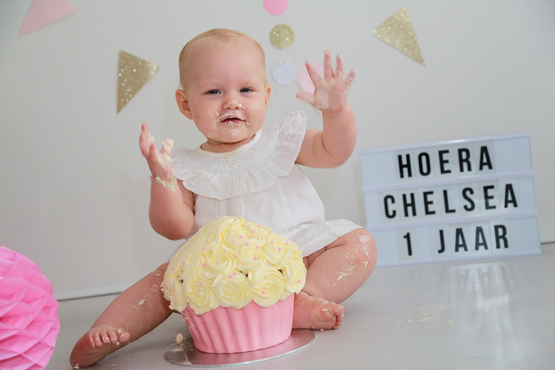 Babyfotografie…<br />Blik terug met een glimlach